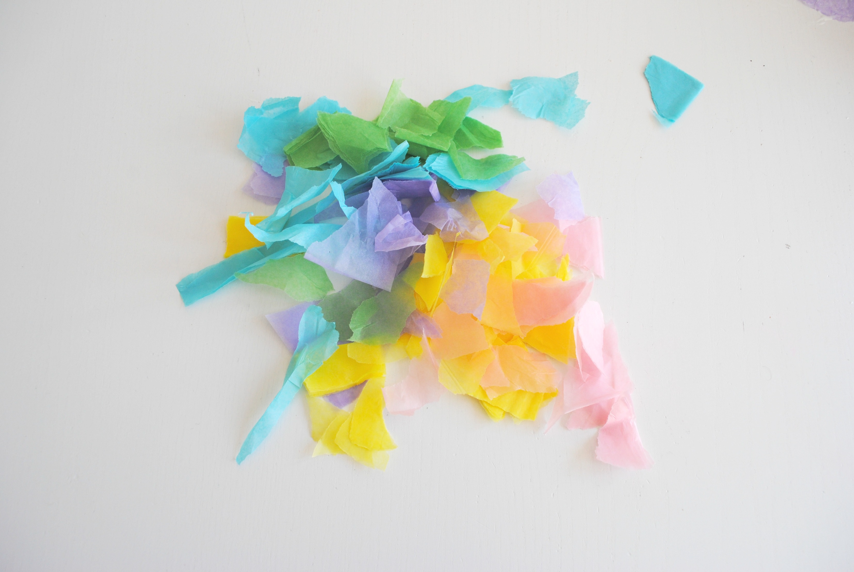 Tear fall colored construction paper into small pieces and glue - Tear Up Or Help Your Toddler Tear Up The Pieces Of Tissue Paper Into Small Bits