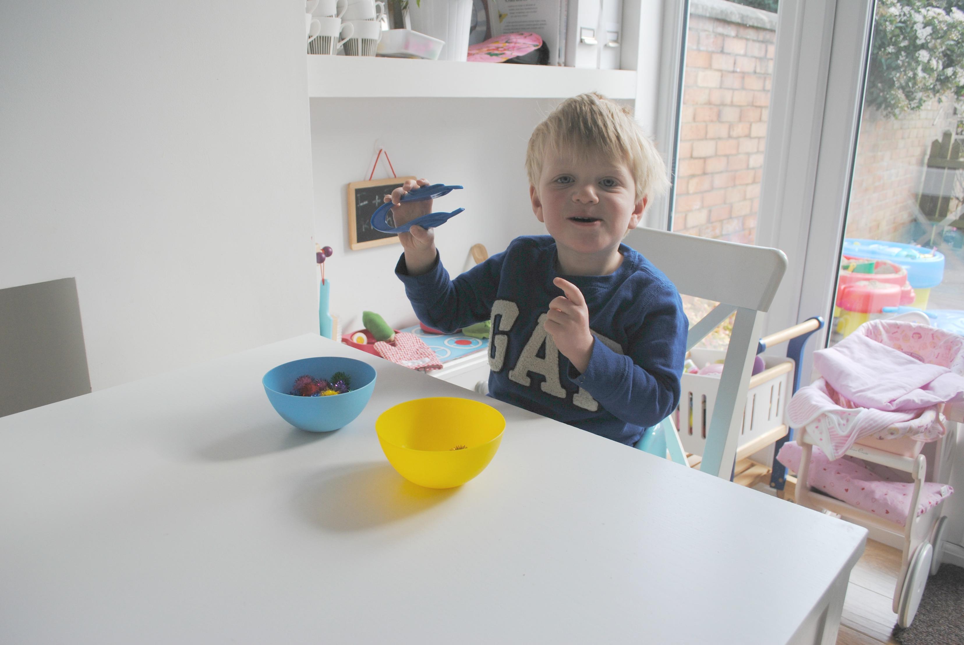 Montessori fine motor skill tweezer transferring activity for Montessori fine motor skills